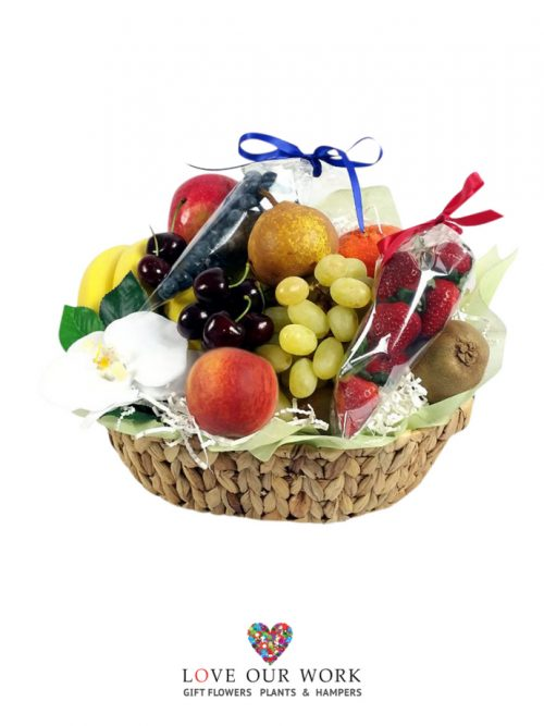Basket of fruit and berries strawberries & blueberries is a thoughtful choice
