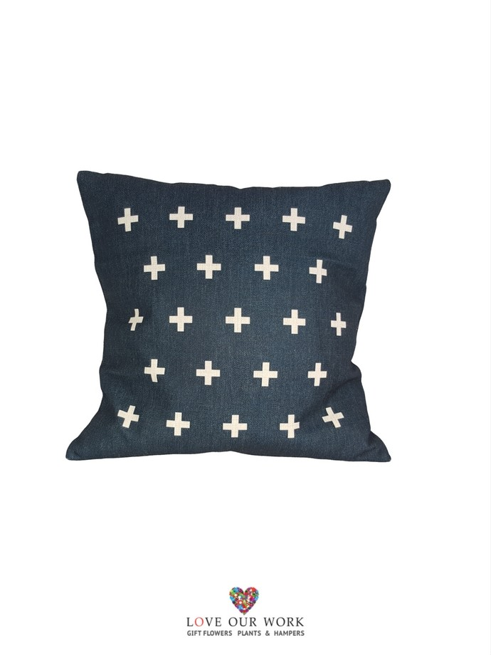 Contemporary navy cross cushions luxuriously soft touch.